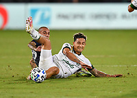 LAKE BUENA VISTA, FL - AUGUST 01: Pablo Bonilla #28 of the Portland Timbers slides to push the ball away from Alexandru Mitrita #22 of New York City FC during a game between Portland Timbers and New York City FC at ESPN Wide World of Sports on August 01, 2020 in Lake Buena Vista, Florida.