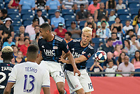 FOXBOROUGH, MA - JULY 27:  Brandon Bye #15 and Antonio Mlinar Delamea #19 leap for a high ball at Gillette Stadium on July 27, 2019 in Foxborough, Massachusetts.