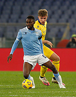 Lazio s Jean-Daniel Akpa Akpro, left, is challenged by Hellas Verona s Matteo Lovato during the Serie A soccer match between Lazio and Hellas Verona at Rome's Olympic Stadium, December 12, 2020.<br /> UPDATE IMAGES PRESS/Riccardo De Luca