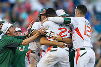Miami Hurricanes celebrate winning the NCAA College baseball World Series game against the Arkansas Razorbacks  on June 15, 2015 at TD Ameritrade Park in Omaha, Nebraska. Miami beat Arkansas 4-3. (Andrew Woolley/Four Seam Images)