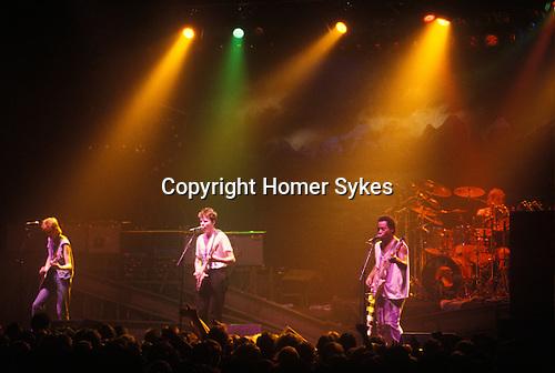 Big Country rock pop band, live performance on stage on tour Scotland Edinburgh. 1980s.