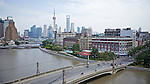 View Over Suzhou Creek.  Broadway Mansion (Astor House Hotel Just Visible Behind), Russian Consulate, Garden Bridge, Capitol Theatre & Office Building, British American Tobacco, Shanghai Electric & The Carlowitz Buildings.  Pudong To The Rear.