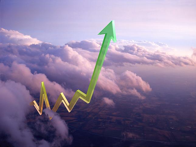 Graph arrow climbing through clouds