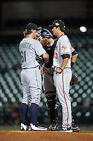 Peoria Javelinas pitching coach Justin Lord (43), of the Baltimore Orioles organization, talks with pitcher Dylan Unsworth (61), of the Seattle Mariners organization, and catcher Nick Ciuffo (13), of the Tampa Bay Rays organization during a game against the Mesa Solar Sox on October 15, 2016 at Sloan Park in Mesa, Arizona.  Peoria defeated Mesa 12-2.  (Mike Janes/Four Seam Images)