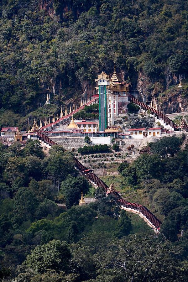 Myanmar, Burma.  Stairway and Elevator leading to Shwe Oo Min Cave on Hillside, Pindaya, Shan State.