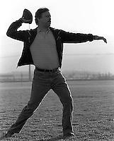 Dave Rifkin throws a football to his son, Devin Rifkin, at the San Ramon City Center Park, 1987.   &#xA;<br />