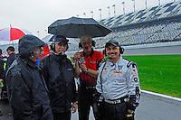 The #95 Crown Royal-NPN Racing BMW/Riley crew braves the rain.