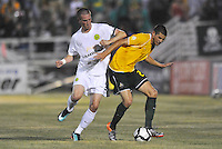 Ryan Pore-Portland Timbers (white), Jeff Cosgriff-AC St Louis...AC St Louis defeated Portland Timbers 3-0 at Anheuser-Busch Soccer Park, Fenton, Mssouri.