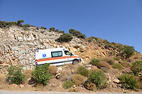 Pictured: An ambulance joins the emergency services personnel in Ikaria, Greece. Thursday 08 August 2019<br /> Re: Rescuers searching for  British scientist Natalie Christopher, 35, who disappeared on the  island of Ikaria, Greece have found her body at the bottom of a ravine.<br /> She was found less than a mile from the hotel in the Kerame area where she was on holiday with her Cypriot partner.<br /> Emergency service staff said that a large rock had dislodged as she fell, causing multiple head injuries.<br /> The woman's body will be kept overnight at the spot so a coroner can examine it on Thursday morning.