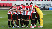 The Brentford players form a huddle ahead of kick-off during Brentford vs Birmingham City, Sky Bet EFL Championship Football at the Brentford Community Stadium on 6th April 2021