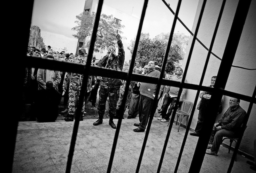 Egyptian military soldiers guard the entrance to the polling station in Tawfikia Secondary School, Shubra, Cairo, Egypt, Monday, Nov. 28, 2011. Voting began on Monday in Egypt's first parliamentary elections since longtime authoritarian leader Hosni Mubarak was ousted in a popular uprising nine months ago. The vote is a milestone many Egyptians hope will usher in a democratic age after decades of dictatorship.