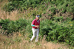 Current leader Bernhard Langer walks away from the 13th tee during day one of The Senior Open Golf Tournament at The Royal Porthcawl Golf Club in South Wales this afternoon.