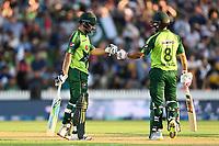 20th December 2020; Hamilton, New Zealand;  Khushdil Shah (L) and Mohammad Hafeez,  New Zealand Black Caps versus Pakistan, International Twenty20 Cricket. Seddon Park, Hamilton, New Zealand.