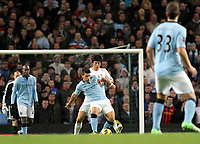 Barclays Premier League, Man City (blue) V Swansea City (white) Etihad Stadium, 27/10812<br /> Pictured: Ki Sung-Yeung of Swansea tackles man of the match Carlos Tevez<br /> Picture by: Ben Wyeth / Athena Picture Agency