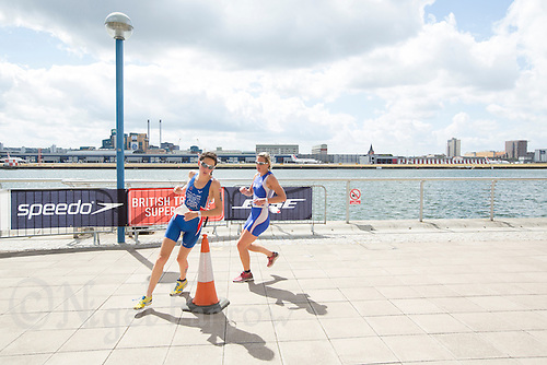 28 JUL 2013 - LONDON, GBR - Hannah Drewett (left) and Katie Henderson (right) turn by Building 1000 during the run for the elite women's race at the 2013 Virgin Active London Triathlon in Excel, Royal Victoria Dock, London, Great Britain (PHOTO COPYRIGHT © 2013 NIGEL FARROW, ALL RIGHTS RESERVED)