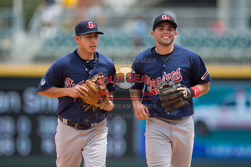 (L-R) Daniel Castro (2) and Jose Peraza (1) of the Gwinnett Braves jog of the field between innings of the game against the Charlotte Knights at BB&T BallPark on July 3, 2015 in Charlotte, North Carolina.  The Braves defeated the Knights 11-4 in game one of a day-night double header.  (Brian Westerholt/Four Seam Images)