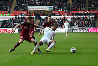 Pictured: Swansea's Wayne Routledge has his shirt pulled by Mathieu Debuchy<br />