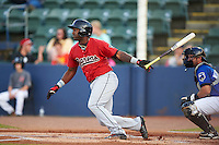 Birmingham Barons outfielder Courtney Hawkins (10) at bat during a game against the Biloxi Shuckers on May 23, 2015 at Joe Davis Stadium in Huntsville, Alabama.  Birmingham defeated Biloxi 2-0 as the Shuckers are playing all games on the road, or neutral sites like their former home in Huntsville, until the teams new stadium is completed.  (Mike Janes/Four Seam Images)