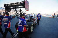 Jul, 8, 2011; Joliet, IL, USA: NHRA top fuel dragster crew members for driver Shawn Langdon during qualifying for the Route 66 Nationals at Route 66 Raceway. Mandatory Credit: Mark J. Rebilas-