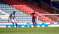 24th April 2021; Ewood Park, Blackburn, Lancashire, England; English Football League Championship Football, Blackburn Rovers versus Huddersfield Town;  Pipa tracked by  Corry Evans of Blackburn Rovers of Huddersfield Town