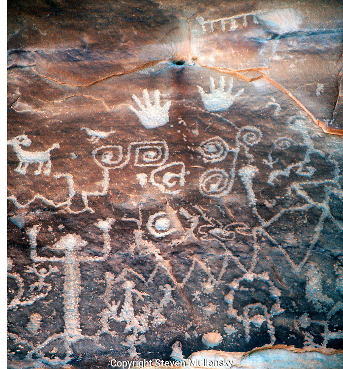 A petroglyph is an image pecked or engraved on a rock surface.  According to one Hopi elder, this petroglyph, found on Mesa Verde?s Petroglyph Point Trail, may tell the story of two clans (the Mountain Sheep Clan and the Eagle Clan) separating from other people and returning to their place of origin. (NPS)