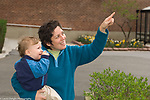"""22 month old todder boy outside with mother language development, mother pointing as boy signs """"bird"""""""