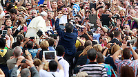 Papa Francesco carezza un bambino al suo arrivo all'udienza generale del mercoledi' in Piazza San Pietro, Citta' del Vaticano, 15 ottobre 2014.<br /> Pope Francis caresses a child as he arrives for his weekly general audience in St. Peter's Square at the Vatican, 15 October 2014.<br /> UPDATE IMAGES PRESS/Isabella Bonotto<br /> <br /> STRICTLY ONLY FOR EDITORIAL USE