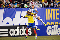 Argentina defender Pablo Zabaleta (4) goes up for a header with Ecuador forward Fidel Martinez (12). Argentina and Ecuador played to a 0-0 tie during an international friendly at MetLife Stadium in East Rutherford, NJ, on November 15, 2013.