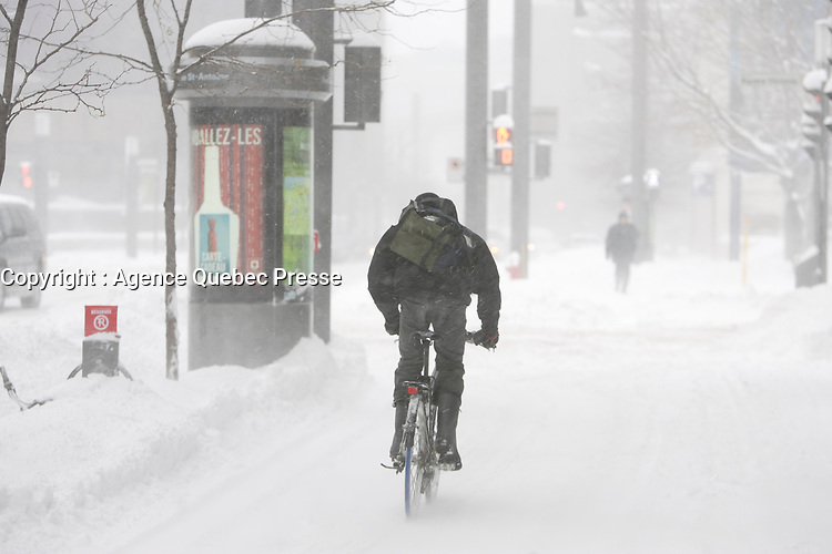 Montreal (Qc) CANADA - December 3rd 2007-.A Bike courrier ride on the sidewalk while .Heavy snow fall on Montreal, more than 30cm is expected...photo : (c) ROUSSEL - Images Distribution.