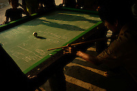 People play pool at an outdoor table near Khe Sanh, Vietnam on 23 February 2010.