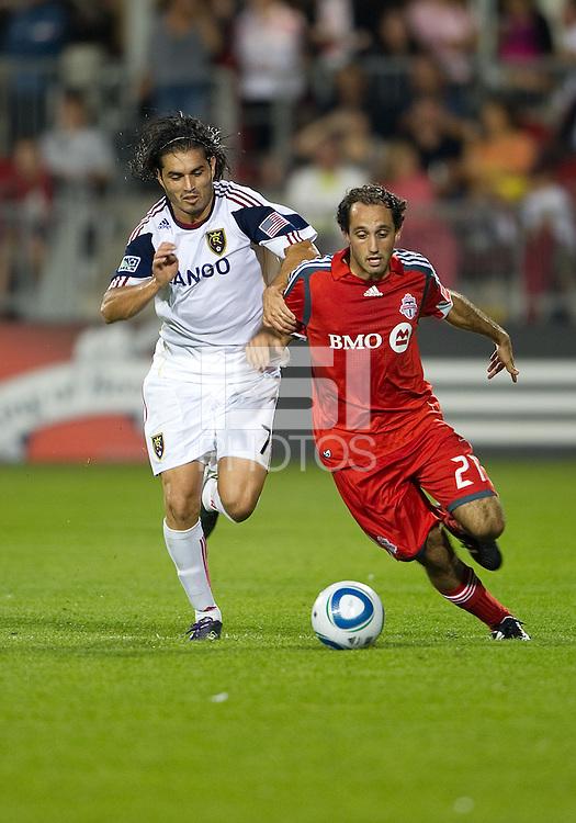 28 August 2010: Real Salt Lake forward Fabian Espindola #7 and Toronto FC midfielder Nick LaBrocca #21in action during a game between Real Salt Lake and Toronto FC at BMO Field in Toronto..The game ended in a 0-0 draw..