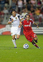 28 August 2010: Real Salt Lake forward Fabian Espindola #7 and Toronto FC midfielder Nick LaBrocca #21in action during a game between Real Salt Lake and Toronto FC at BMO Field in Toronto..The game ended in a 0-0 draw..