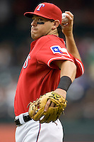 Texas Rangers second baseman Ian Kinsler (5) warms up before the game against the Oakland Athetics in American League baseball on May 11, 2011 at the Rangers Ballpark in  Arlington, Texas. (Photo by Andrew Woolley / Four Seam Images)
