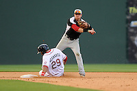 Second baseman Ryan Rua (2) of the Hickory Crawdads goes up high after the throw as a sliding Boss Moanaroa (29) of the Greenville Drive breaks up the double play in a game on Friday, June 7, 2013, at Fluor Field at the West End in Greenville, South Carolina. Greenville won the resumption of this May 22 suspended game, 17-8. (Tom Priddy/Four Seam Images)