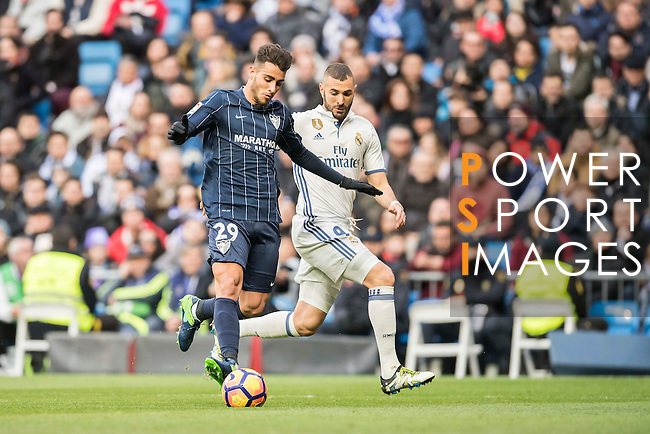 Luis Munoz (l) of Malaga CF battles for the ball with Karim Benzema of Real Madrid during their La Liga 2016-17 match between Real Madrid and Malaga CF at the Estadio Santiago Bernabéu on 21 January 2017 in Madrid, Spain. Photo by Diego Gonzalez Souto / Power Sport Images