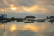 Camden Harbor in downtown Camden, Maine at sunrise during the autumn months. The town of Camden is located on the coast of Maine.