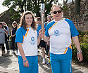 Hollywood actor and current Rector of The University of Dundee, Brian Cox, passes the Queen's Baton on to Rachael Law, as it leaves Rosslyn Chapel.
