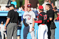 Mahoning Valley Scrappers manager David Wallace #17 talks with Dann Bilardello #32 and umpires Ryan Additon (left) and John Libka (right) during a game against the Batavia Muckdogs at Dwyer Stadium on July 4, 2011 in Batavia, New York.  Batavia defeated Mahoning Valley 3-2.  (Mike Janes/Four Seam Images)