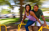Young black african american couple having fun spinning with blur with laughing anf joyful feelngs