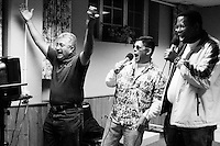 Parents of children with Cockayne Syndrome unwind with some karaoke at the Share and Care Network's annual retreat held in Montauk, NY on March 18, 2003.