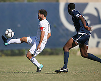 Jose Colchao #11 of Georgetwn University hooks the ball over William Cason #26 of Villanova University during a Big East match at North Kehoe Field, Georgetown University on October16 2010 in Washington D.C. Georgetown won 3-1.