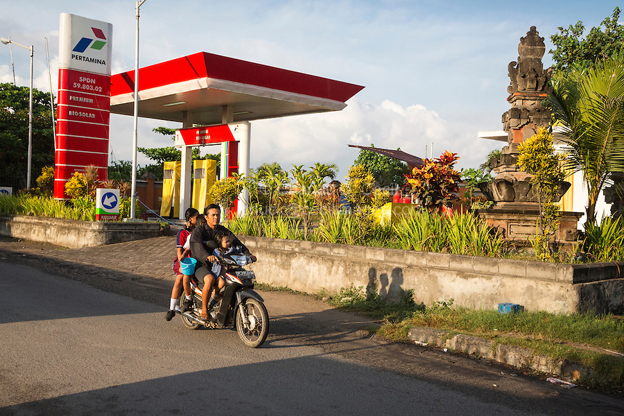 Bali, Indonesia.  Father and Three Children on a Motorbike, no Helmets.