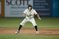Grant Koch (23) of the Greensboro Grasshoppers takes his lead off of first base against the Wilmington Blue Rocks at First National Bank Field on May 25, 2021 in Greensboro, North Carolina. (Brian Westerholt/Four Seam Images)
