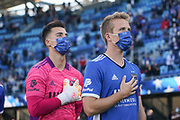 SAN JOSE, CA - MAY 22: JT Marcinkowski #1 and Jackson Yueill #14 of the San Jose Earthquakes during the national anthem before a game between Sporting Kansas City and San Jose Earthquakes at PayPal Park on May 22, 2021 in San Jose, California.