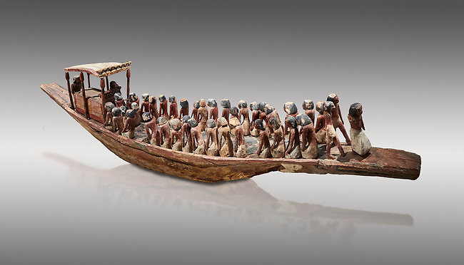 Ancient Egyptian model of a funerary boat with oarsman and a sarcopagus under a canope, Middle Kingdom (1980-1700 BC. Egyptian Museum, Turin. Cat 1209. Grey Background.<br /> <br /> Funerary boats were probably believed to carry the deceased sould to the afterlife. Wooden tomb models were an Egyptian funerary custom throughout the Middle Kingdom in which wooden figurines and sets were constructed to be placed in the tombs of Egyptian royalty.