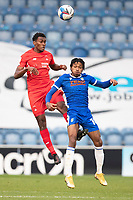 Tunji Akinola, Leyton Orient out jumps Jevani Brown, Colchester United during Colchester United vs Leyton Orient, Sky Bet EFL League 2 Football at the JobServe Community Stadium on 14th November 2020