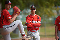 Canada Junior National Team pitching coach Jeff Francis (46) watches pitcher Justin Thorsteinson (26) in the bullpen during an exhibition game against the Toronto Blue Jays on March 8, 2020 at Baseball City in St. Petersburg, Florida.  (Mike Janes/Four Seam Images)