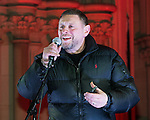 """© Joel Goodman - 07973 332324 .  03/02/2015 . Manchester , UK . Madchester star SHAUN RYDER , speaks to the crowd , at the demonstration . Demonstration organised by the Labour Party on the steps of Manchester City Council in Albert Sqaure , Manchester , under the banner """"manVcam"""" ( Manchester vs Cameron ) . Organisers say Manchester - along with Liverpool and Birmingham - have suffered larger cuts than other regional authorities , whilst southern regions such as Surrey , Hampshire and West Sussex have all seen increases in government funding . Photo credit : Joel Goodman"""