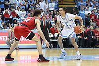 CHAPEL HILL, NC - FEBRUARY 25: Cole Anthony #2 of the University of North Carolina is defended by Devon Daniels #24 of North Carolina State University during a game between NC State and North Carolina at Dean E. Smith Center on February 25, 2020 in Chapel Hill, North Carolina.