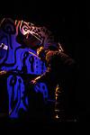 Mexican artist Jazzamoart works on an instalation while jazz singer Iraida Noriega sings during a jazz session along with jazz musician Alex Otaola at Mexico City's Fundacion Sebastian's auditorium, March 25, 2011. Photo by Heriberto Rodriguez